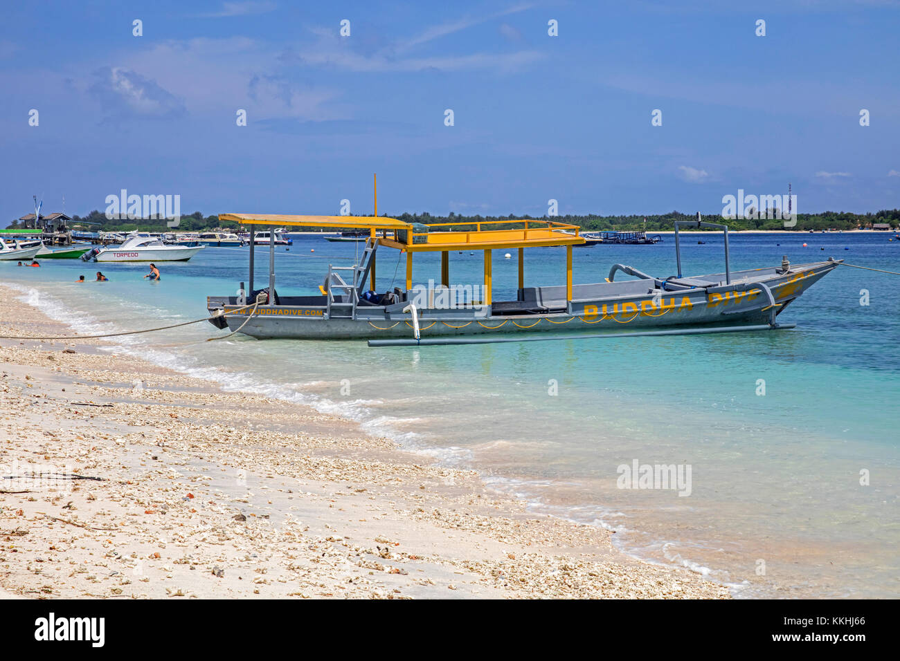 Outrigger tourist boat on the island Gili Trawangan, largest of Lombok's Gili Islands, Indonesia - Stock Image