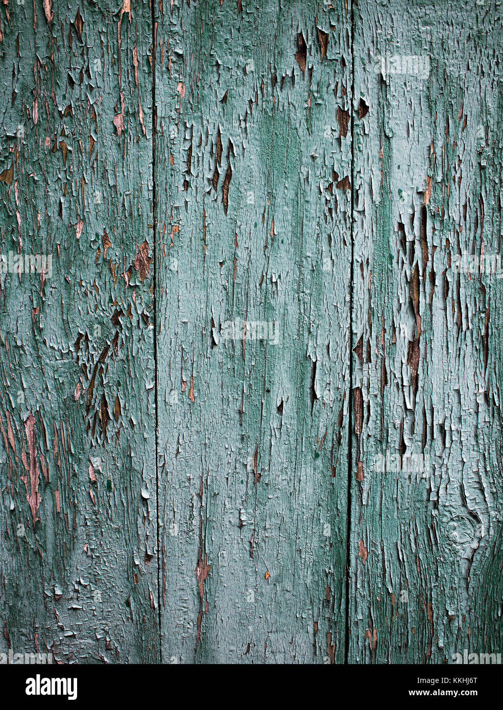 Background of boards painted in green. Cracked green paint on a wooden base. - Stock Image