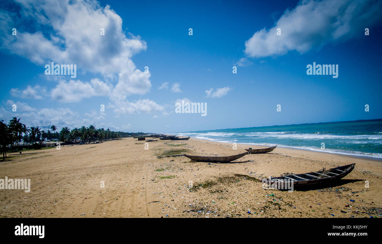 Canoes at Rest on the Beach in Lagos Nigeria, There is Time for Everything A Time to Work and A Time to Rest, A - Stock Image