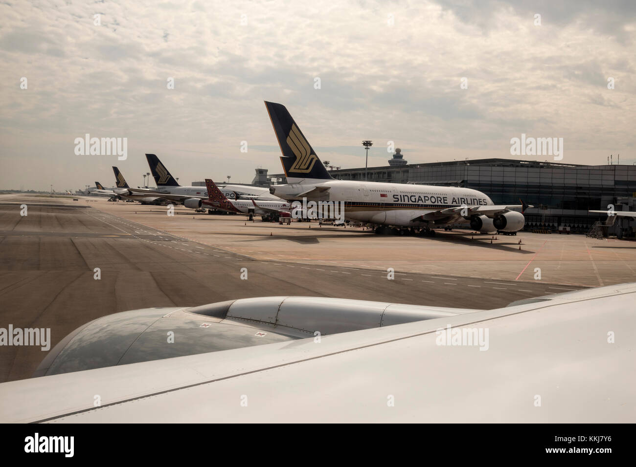 4 Singapore Airlines A380 aircraft on the apron at Changi International Airport Singapore - Stock Image