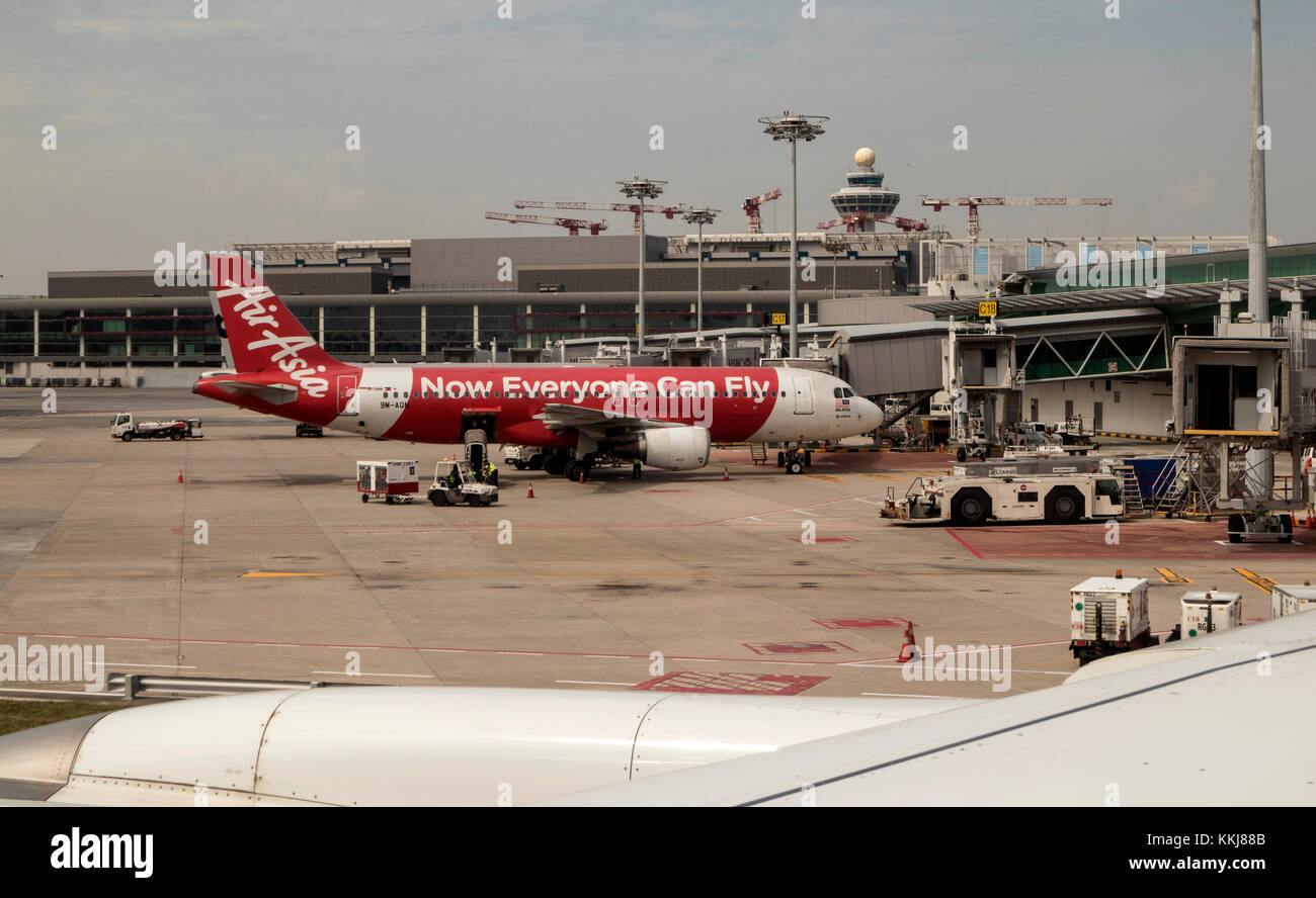 An A320 - 216 Air Asia plane, 9M AQN on the apron at Changi International Airport Singapore - Stock Image