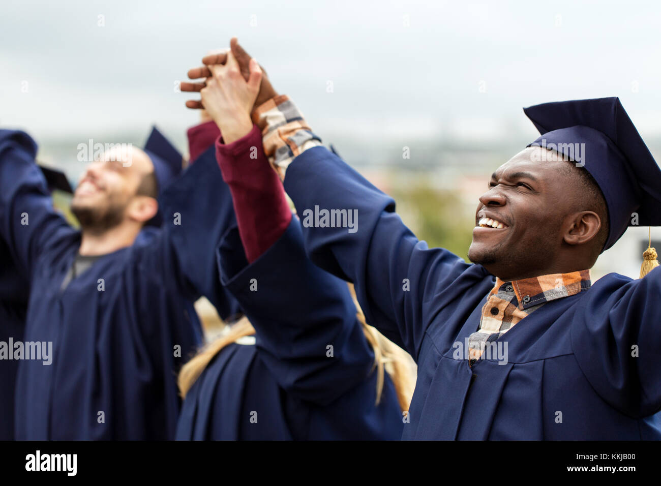 happy students celebrating graduation - Stock Image