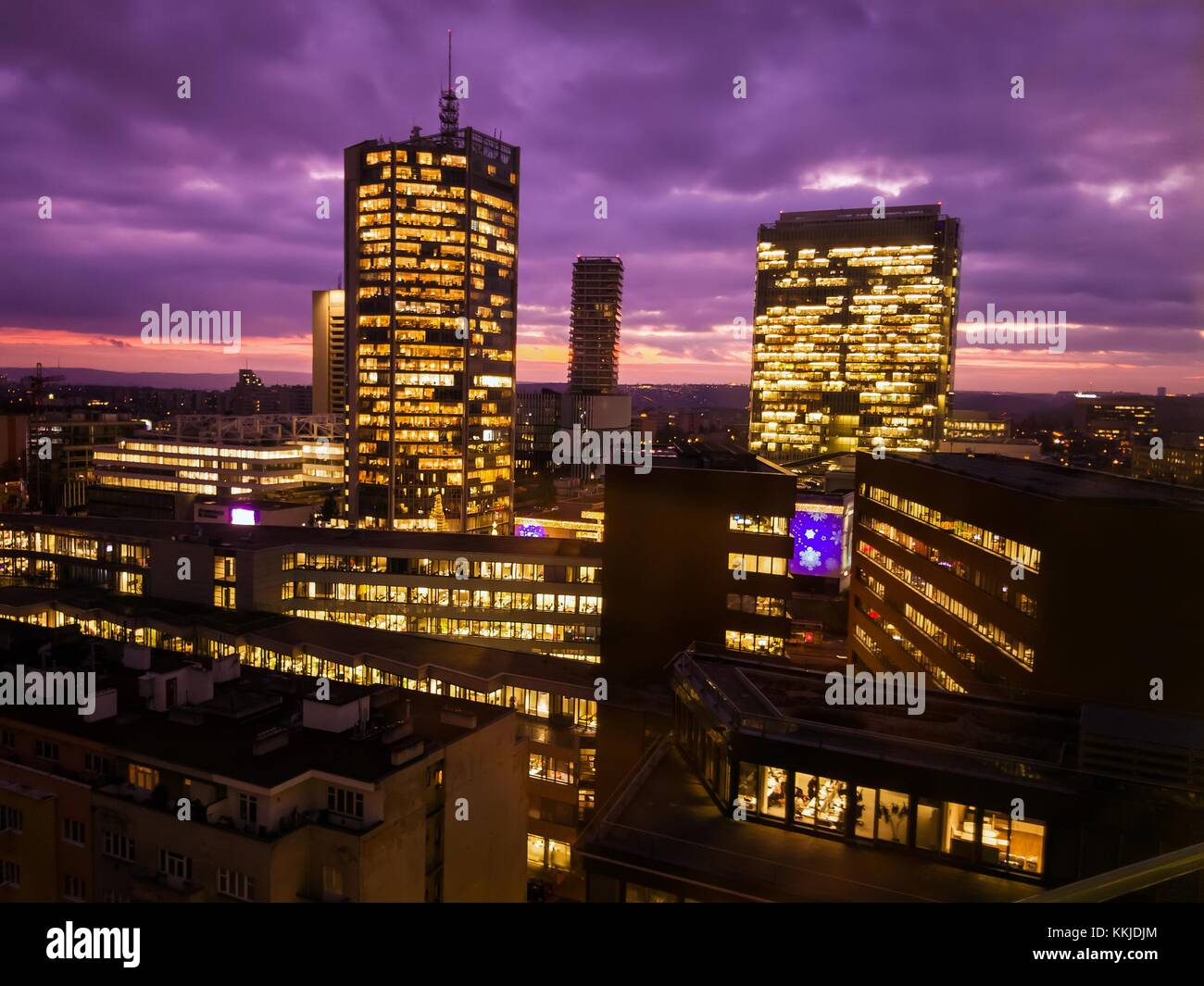 Prague skyscrapers in blue hour with purple sky. Modern office architecture. - Stock Image