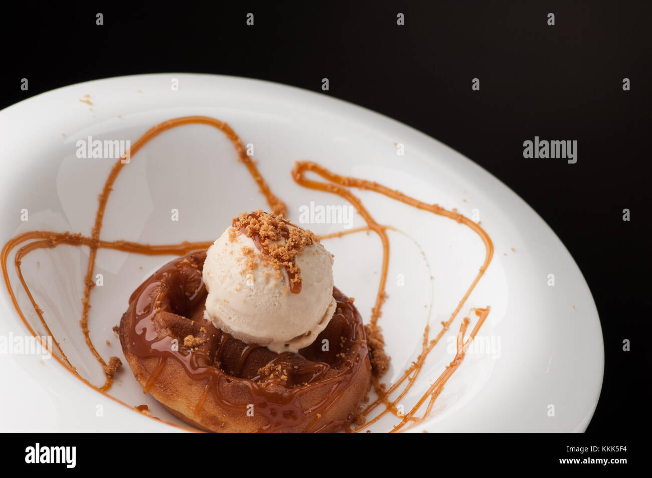 ice cream in a round white plate - Stock Image