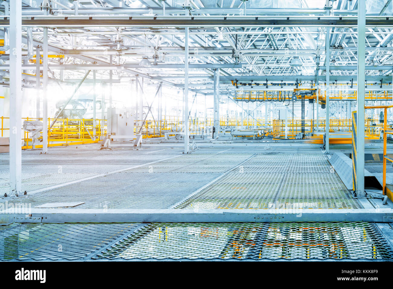 Car production line workshop, steel ceiling and car shell. - Stock Image