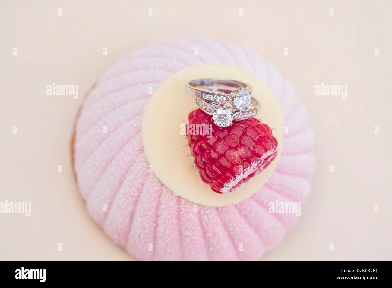 Engagement set of rings on the top of the sweet cake Stock Photo ...