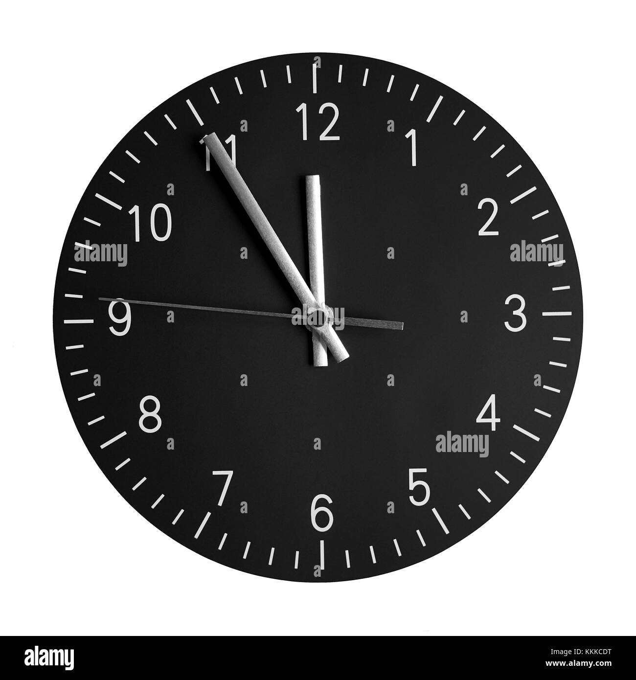 isolated wall clock with its hands at 5 to 12 - Stock Image