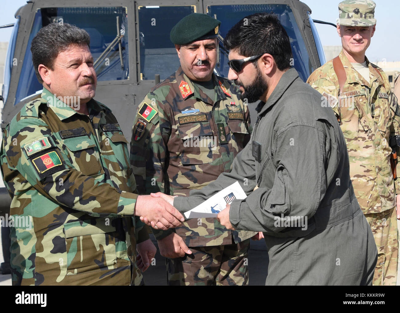 An Afghan Air Force pilot receives a certificate during a UH-60 Black Hawk Aircraft Qualification Training graduation - Stock Image