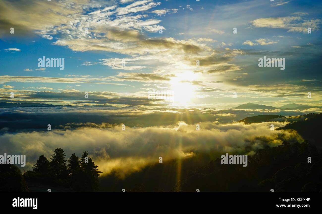 Mountain scenery with cloudscape at sunrise in Paro, Bhutan. Stock Photo