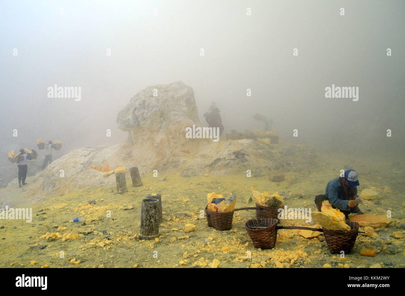 The sulfur mine in Kawah Ijen near Banyuwangi, East Java - Indonesia. The smoke is toxic Sulfur Dioxide gas being - Stock Image