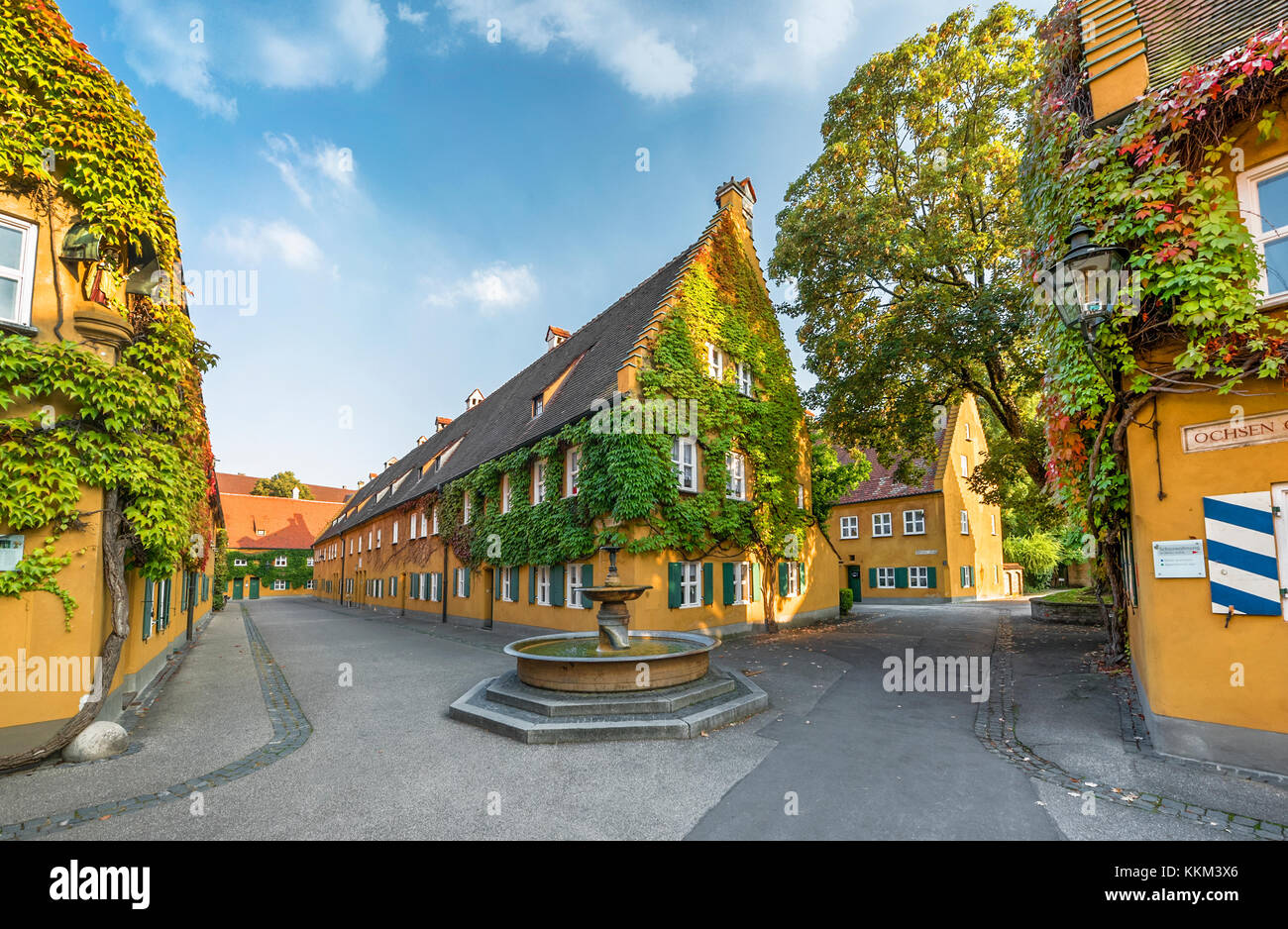 At the streets of the unique Fuggerei social living complex - Stock Image