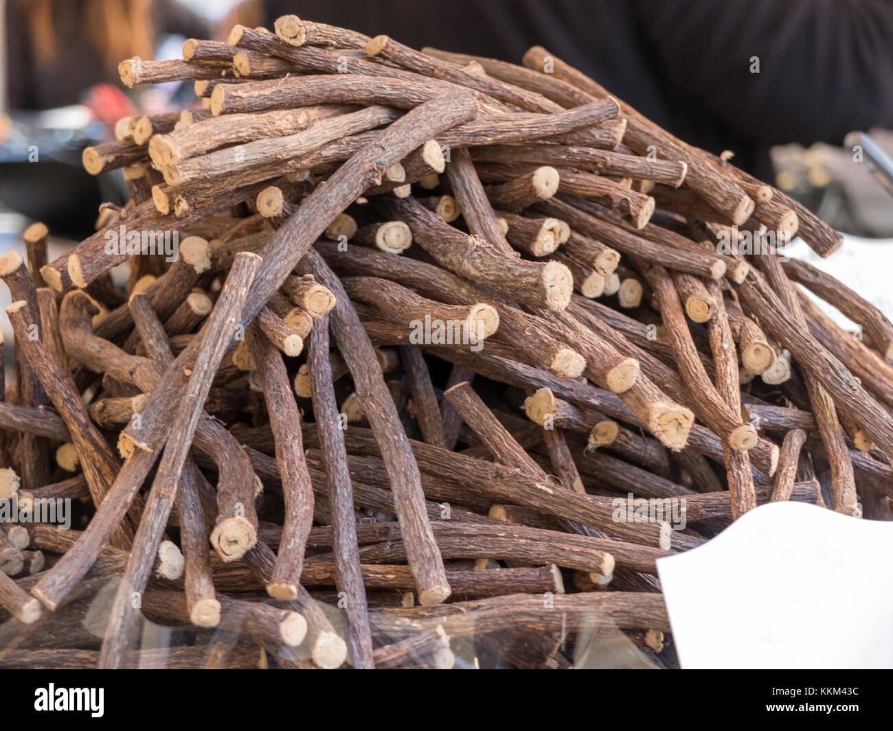 Close up with a bunch of raw licorice root sticks. - Stock Image