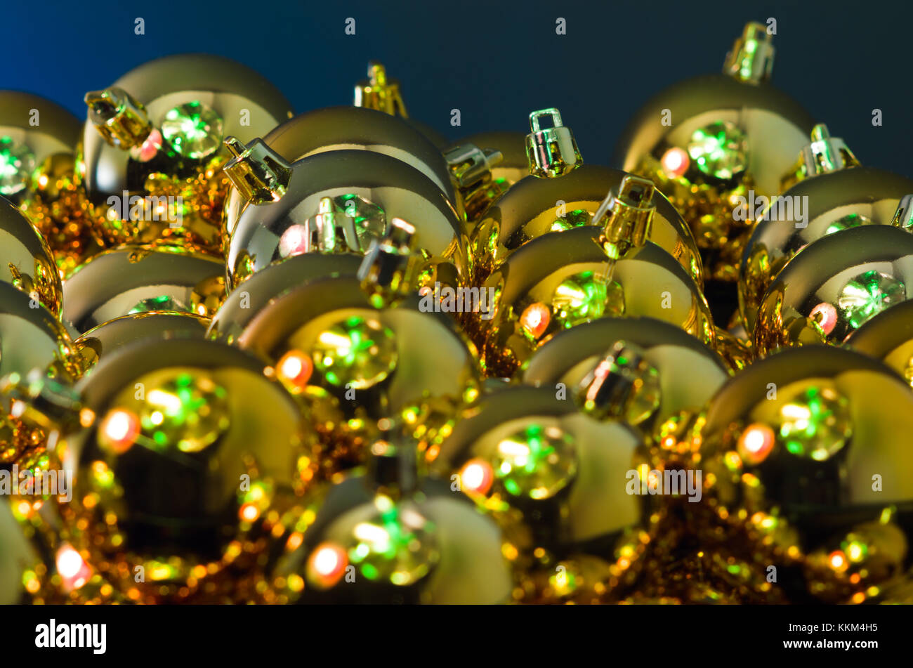 Close-up view of set of luxury Christmas baubles in colourful warm light. - Stock Image