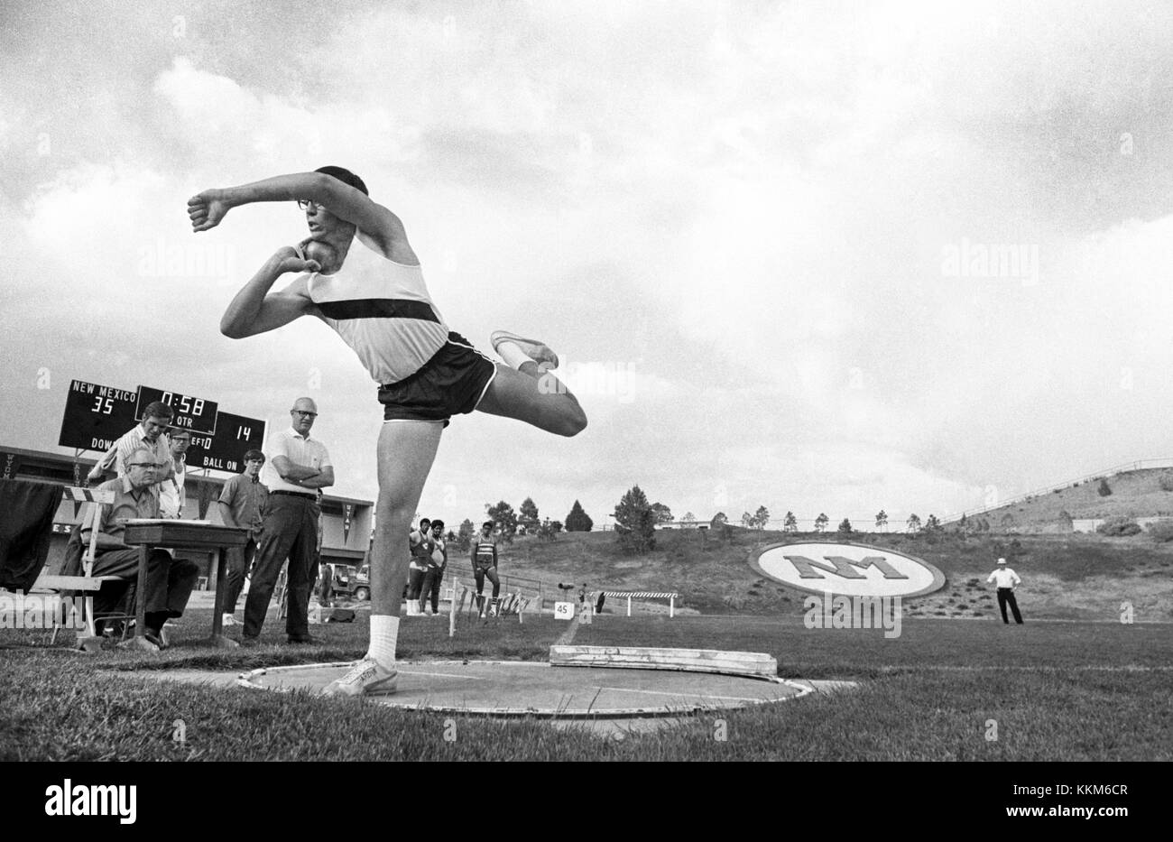 A high school shot putter throws the shot at a state high school track meet in Albuquerque, New Mexico - Stock Image