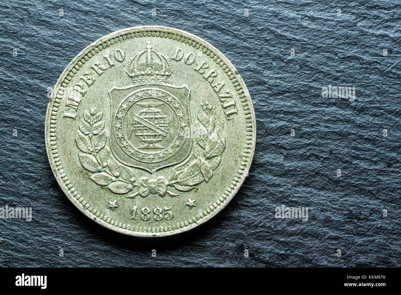 Antique coin of 100 Reis, from the former Brazilian Empire, dated from 1885. Florianopolis, Santa Catarina, Brazil. - Stock Image
