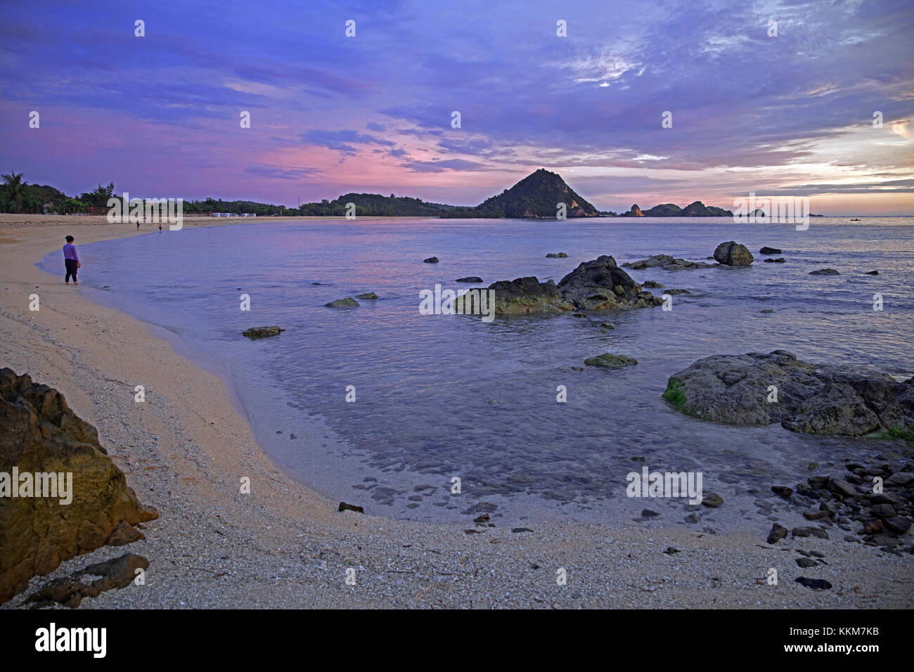 Tourists on Kuta beach at sunset on the island Lombok, Lesser Sunda Islands, Indonesia - Stock Image