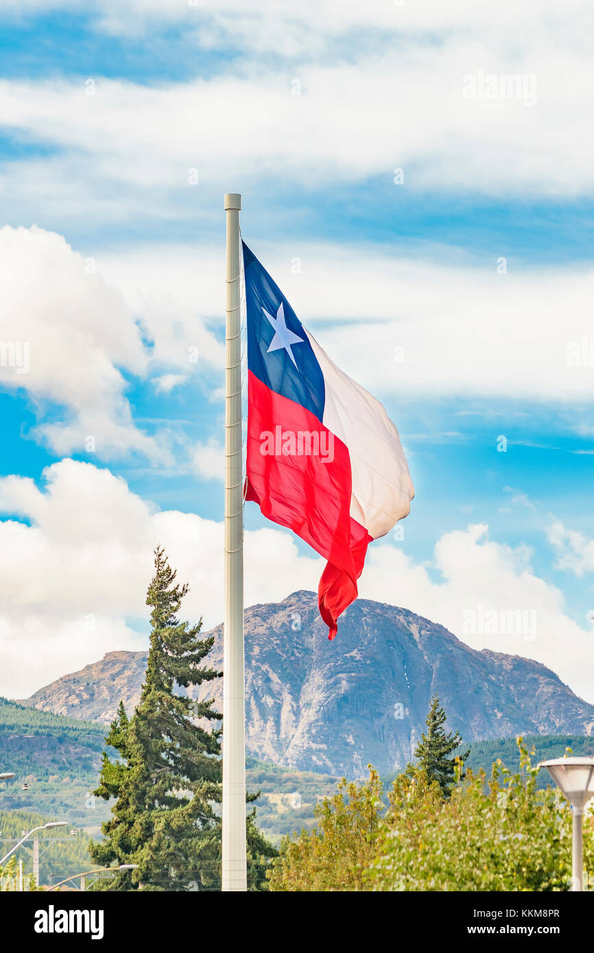 Chile flag flaming at coyhaique square, Aysen district. - Stock Image