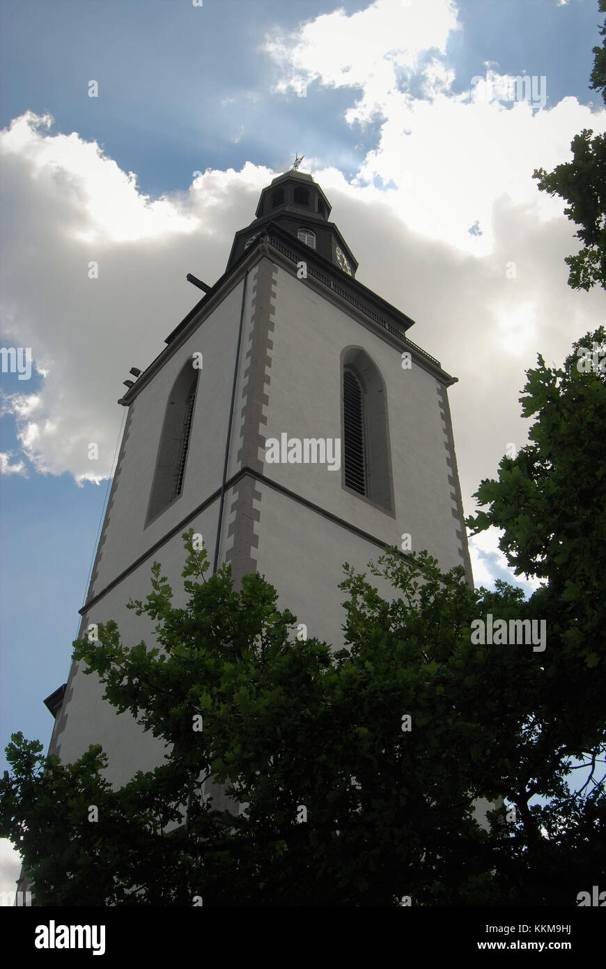 Churchyard with town church tower in Giessen. During the war broken, later, however, restored town church tower - Stock Image