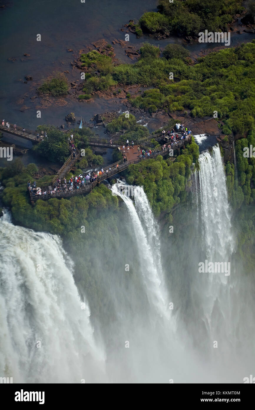 Tourists on viewing platform and Devil's Throat (Garganta do Diablo), Iguazu Falls, on Brazil - Argentina Border, - Stock Image