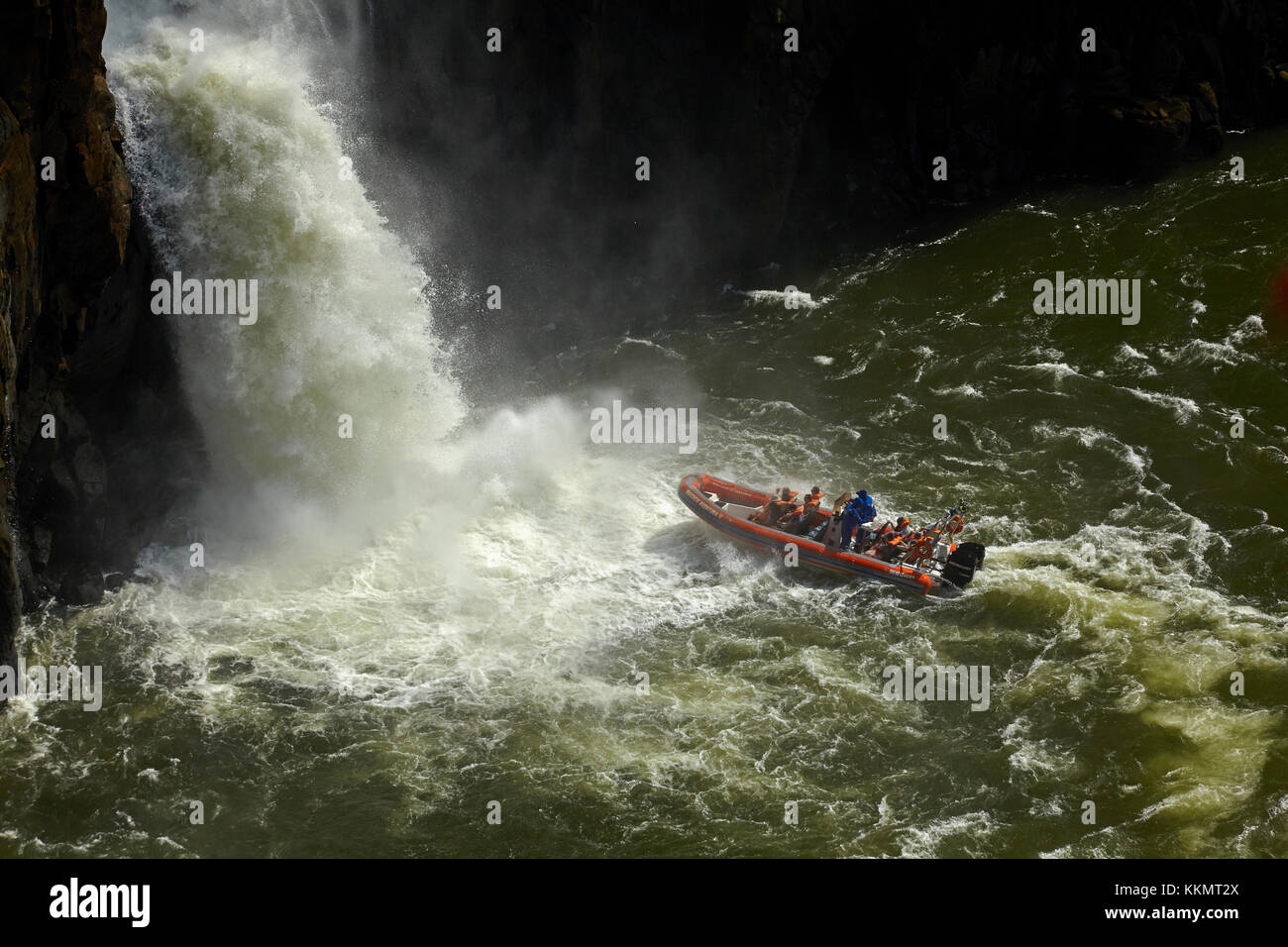 Tourist boat under Iguazu Falls, Brazil - Argentina Border, South America - Stock Image