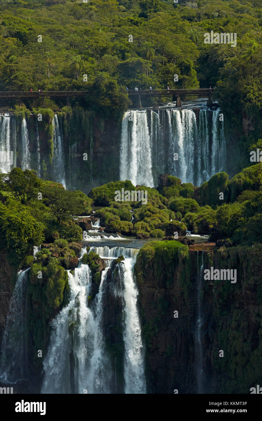 Tourists on walkway above Iguazu Falls, Argentina, seen from Brazil side, South America Stock Photo