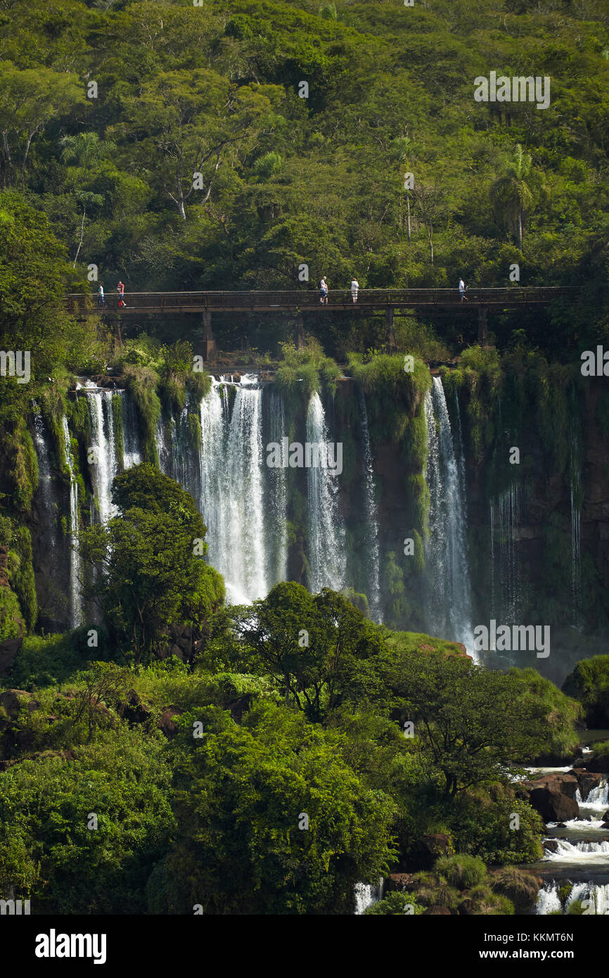 Tourists on walkway above Iguazu Falls, Argentina, seen from Brazil side, South America - Stock Image
