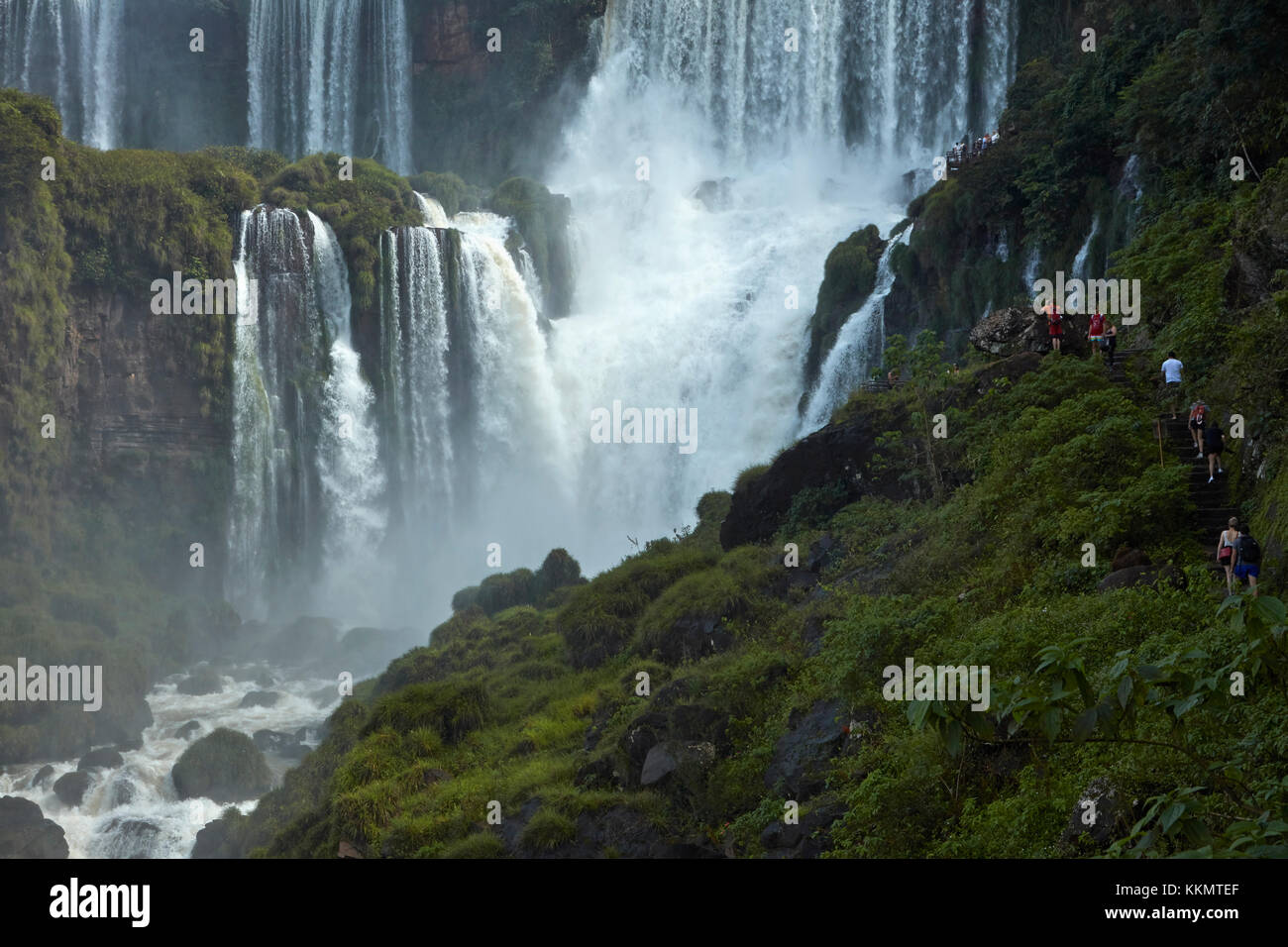 Tourists on track by Iguazu Falls, Argentina, South America - Stock Image