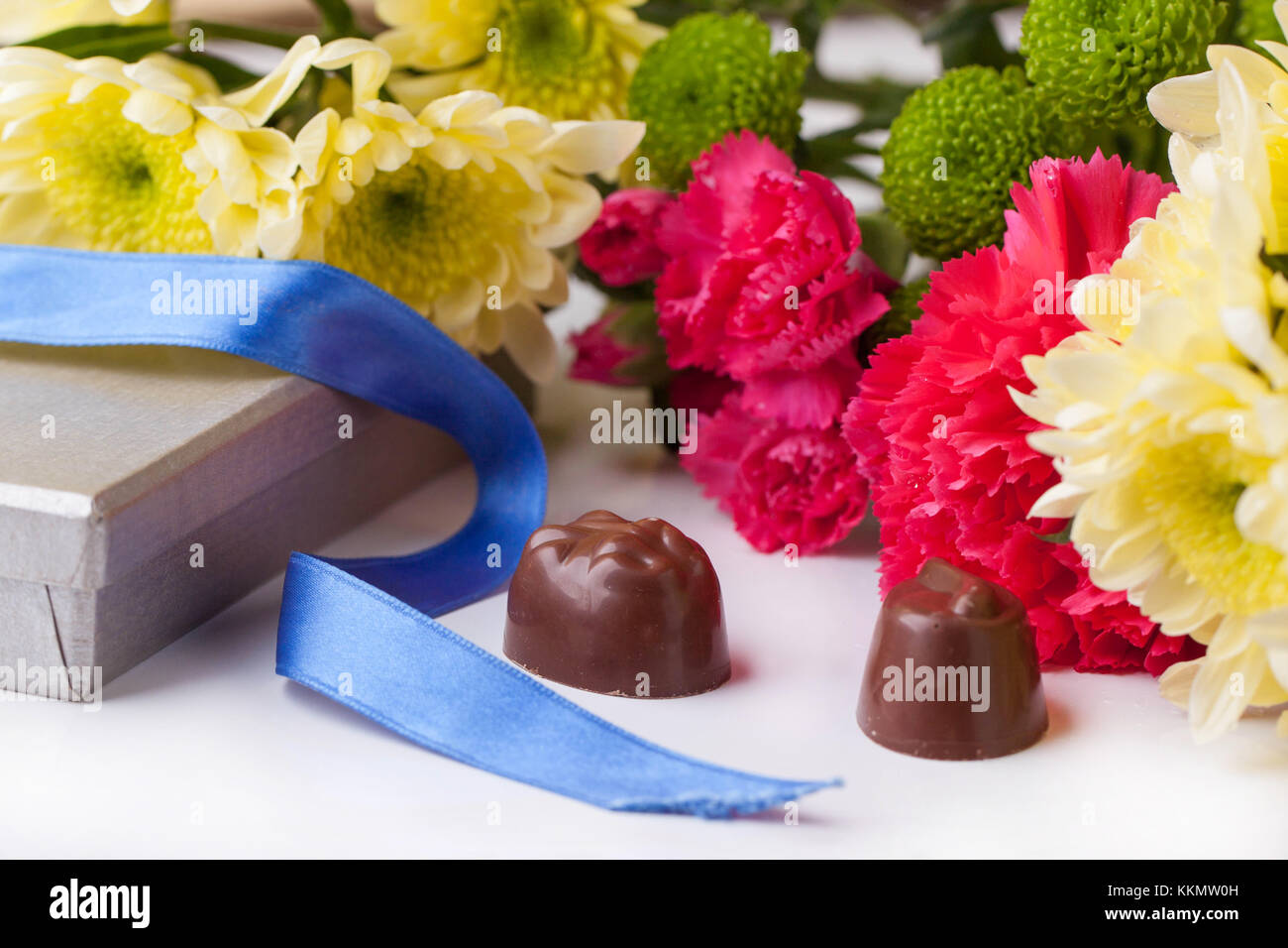Black And White Chocolate Candies And Bouquet Of Carnation And Stock