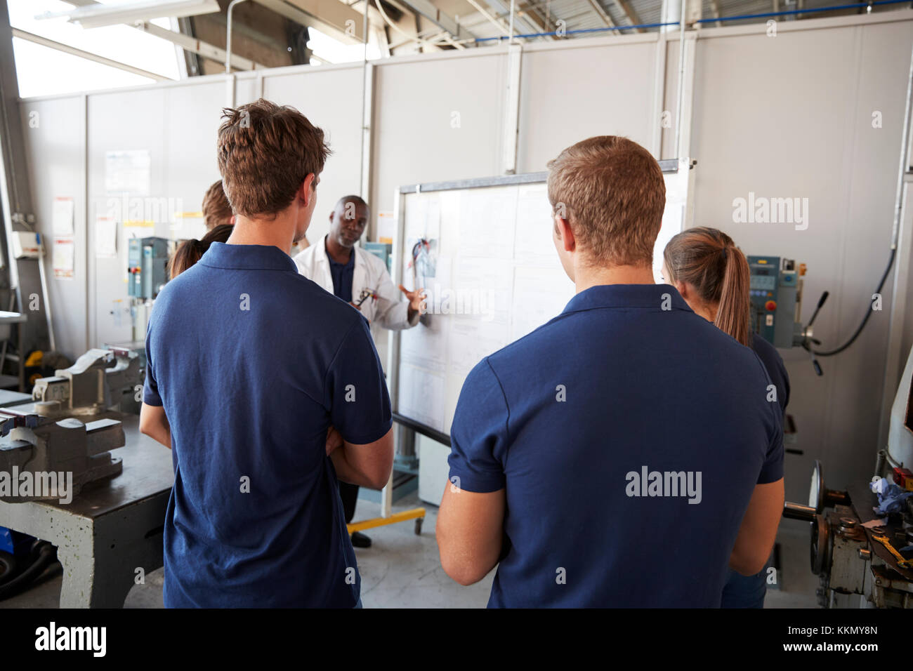 Engineering apprentices at a training presentation, back view - Stock Image