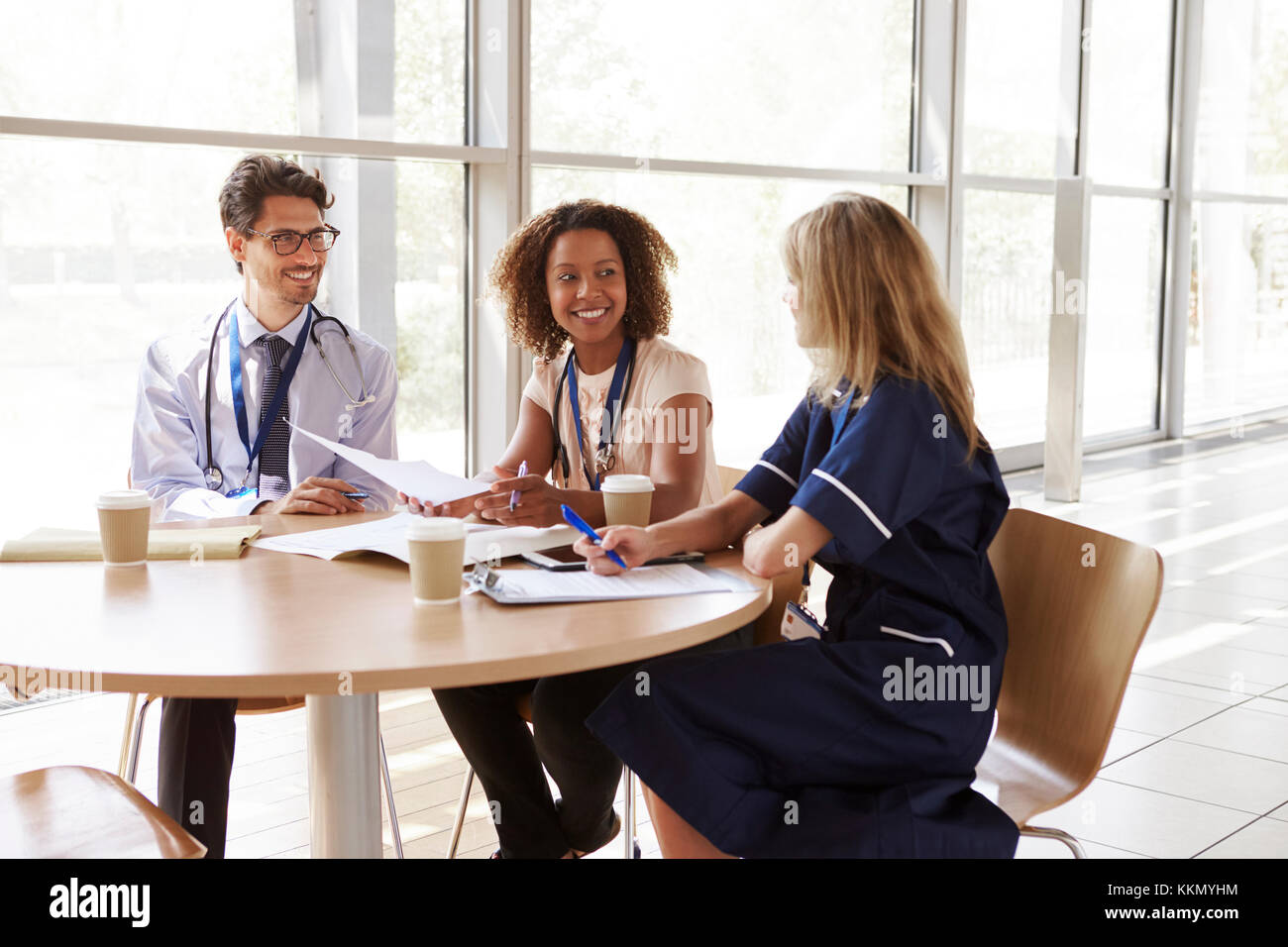 Senior healthcare workers in consultation in a meeting room - Stock Image