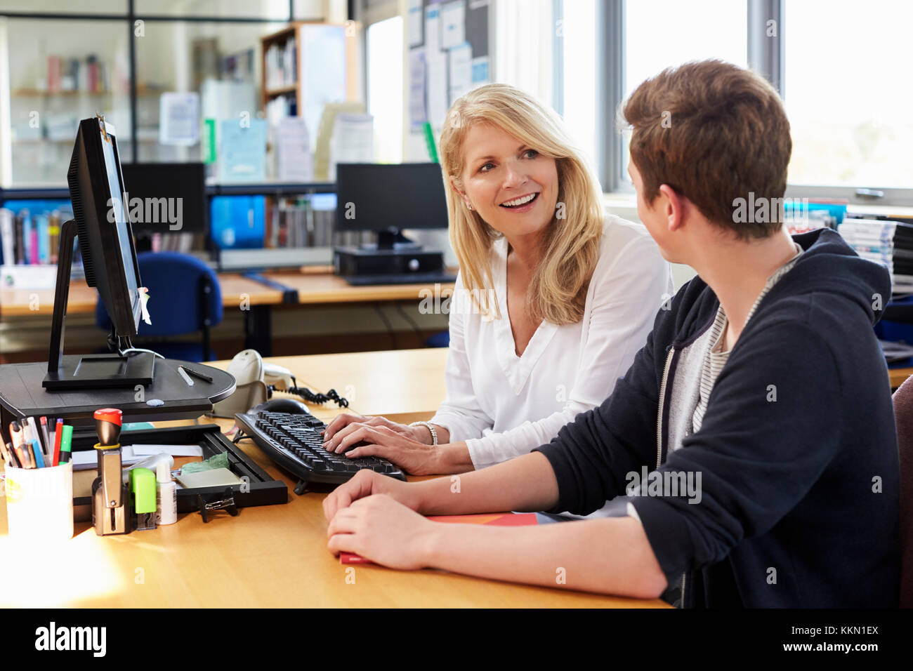 Female Careers Advisor Meeting Male College Student - Stock Image