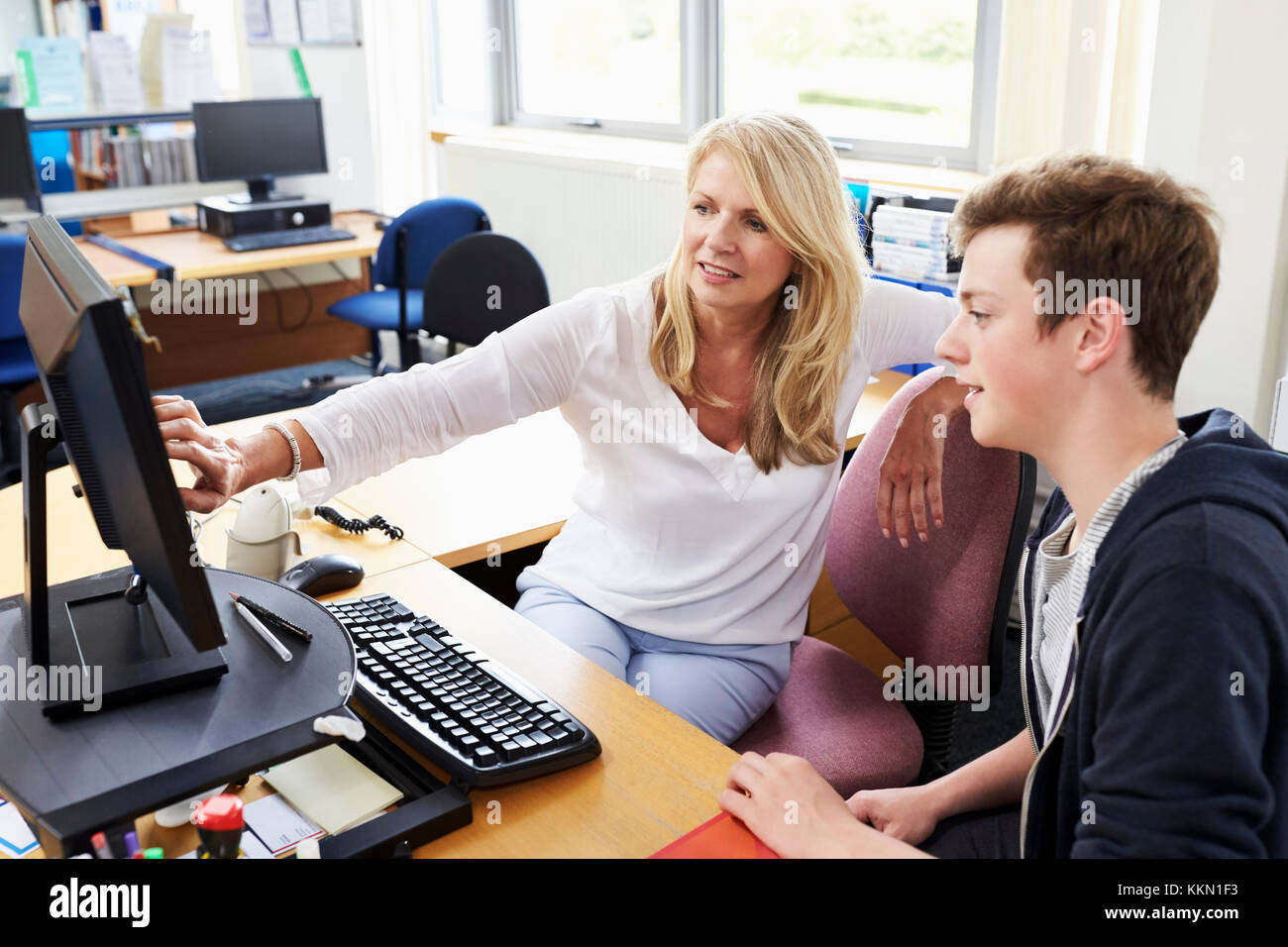 Female Careers Advisor Meeting Male College Student - Stock Image