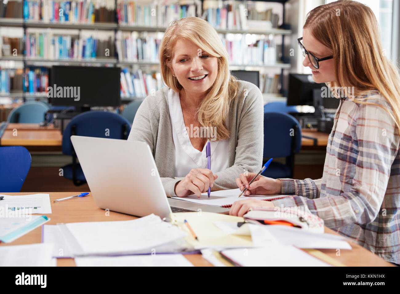College Student Has Individual Tuition From Teacher In Library - Stock Image