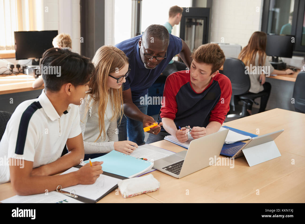 Design Students With Teacher Working In CAD/3D Printing Lab Stock Photo