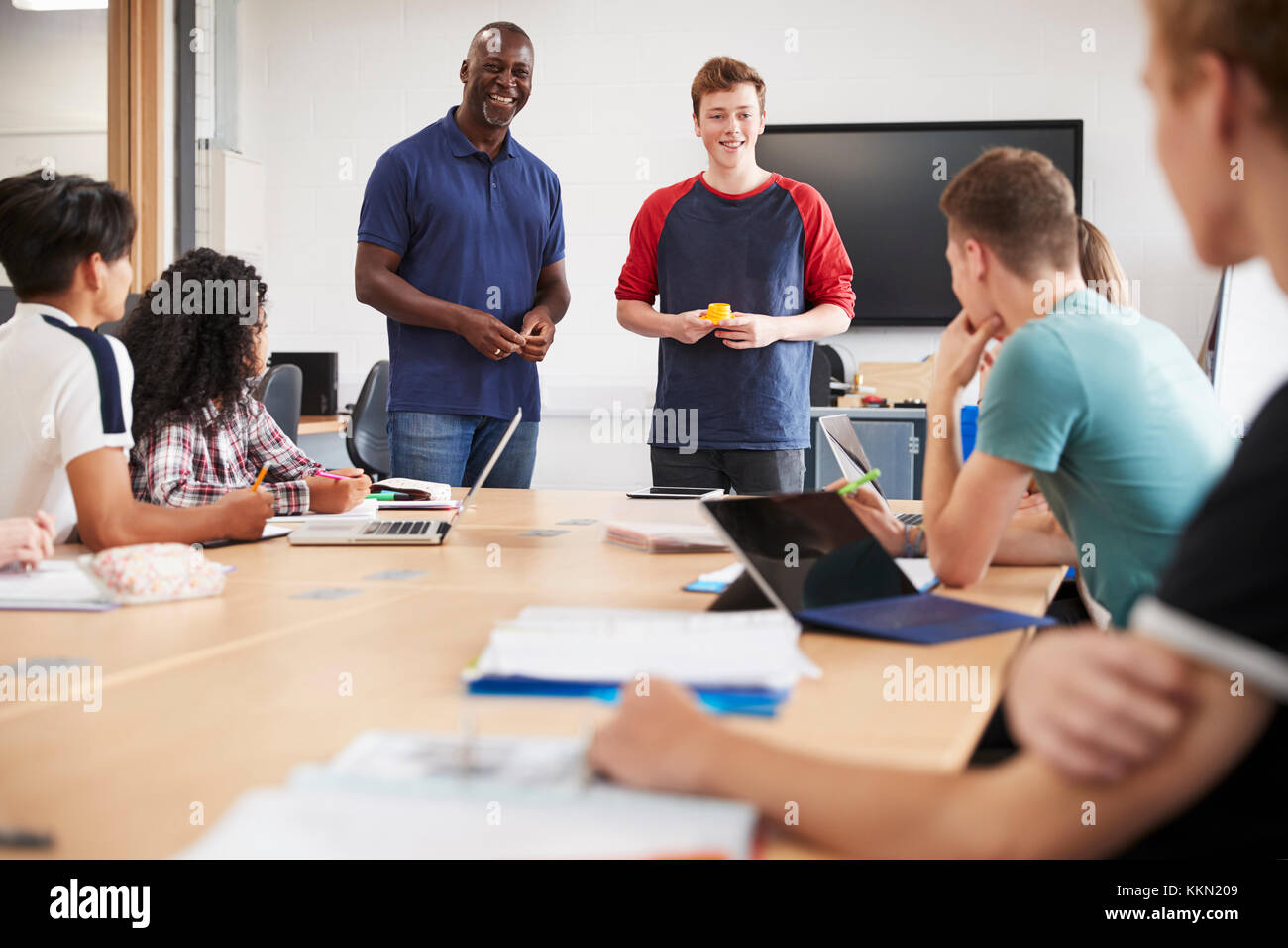 College Student Making Presentation In CAD/3D Printing Class - Stock Image
