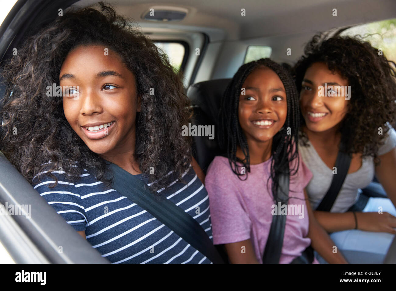 Family With Teenage Children In Car On Road Trip - Stock Image
