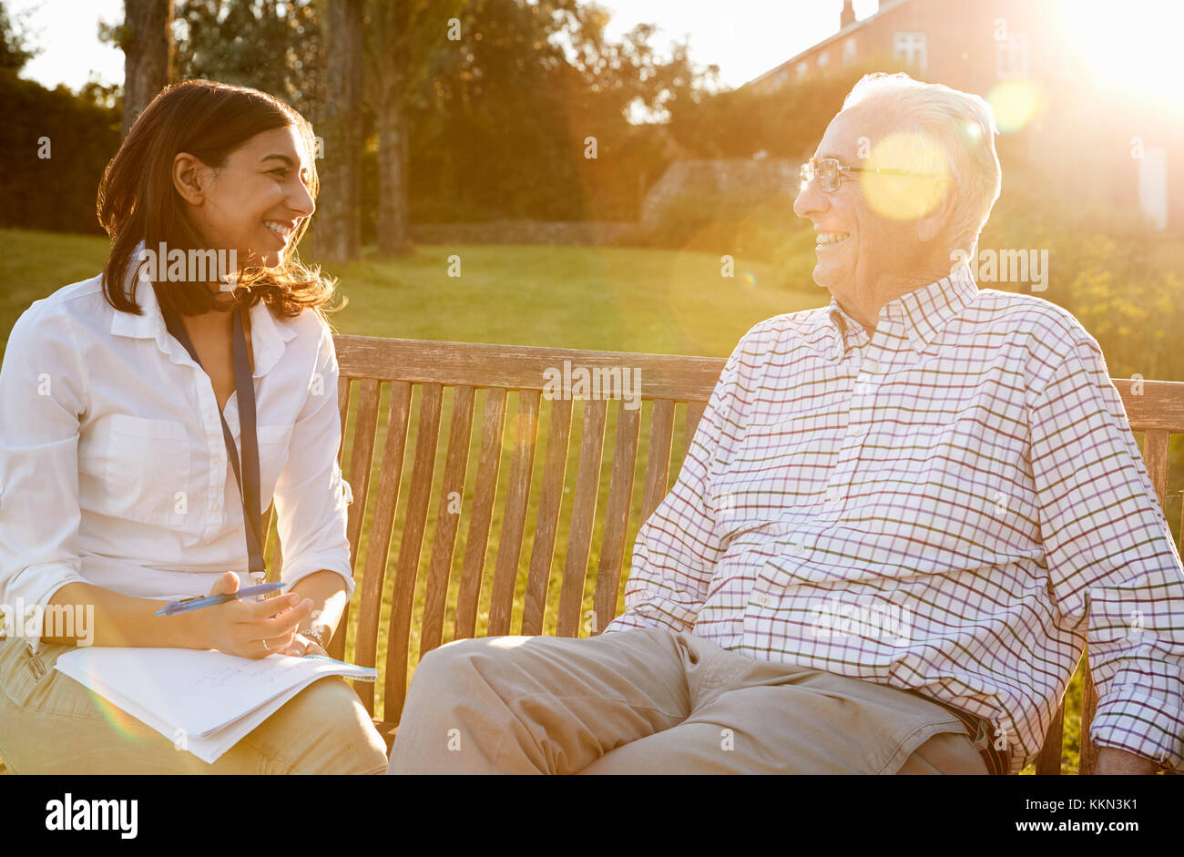Woman Visiting Senior Male Relative In Assisted Living Facility - Stock Image
