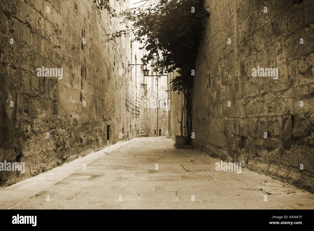 Old narrow Street in Mdina Malta in sepia. - Stock Image