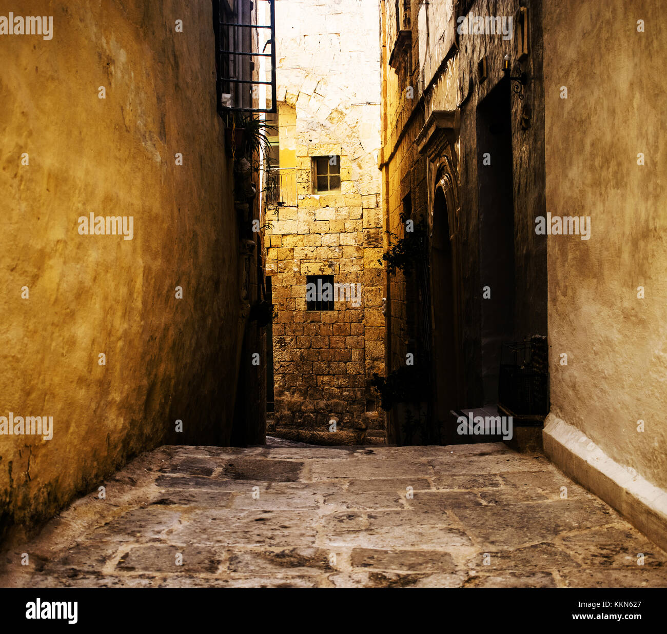 A narrow typical and historic road in Mdina, Malta - Stock Image