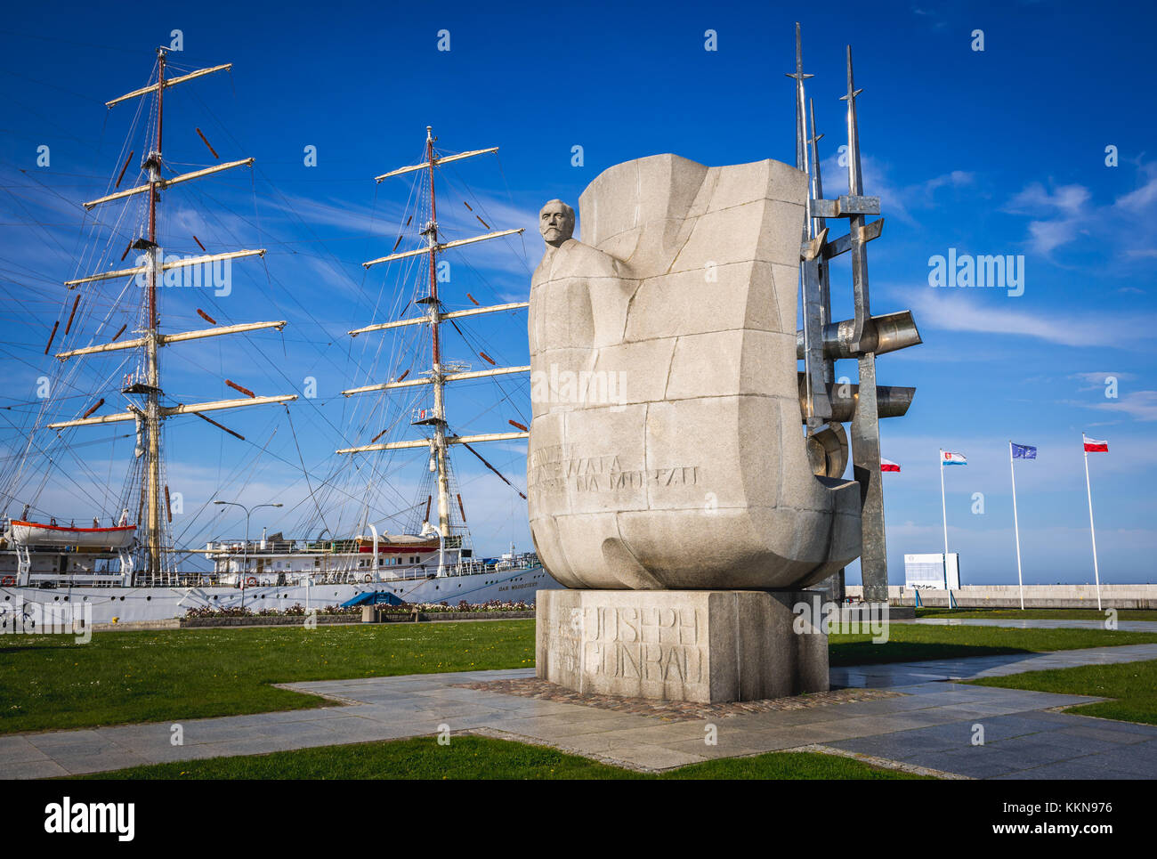 Joseph Conrad monument in Port in Gdynia city, Pomeranian Voivodeship of Poland. Sail training ship Dar Mlodziezy Stock Photo