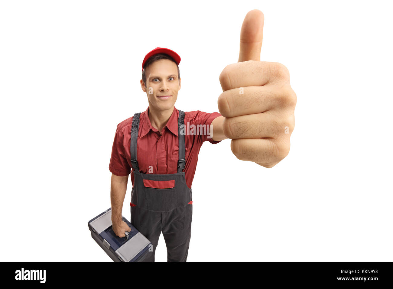 Serviceman with a toolbox making a thumb up gesture isolated on white background - Stock Image