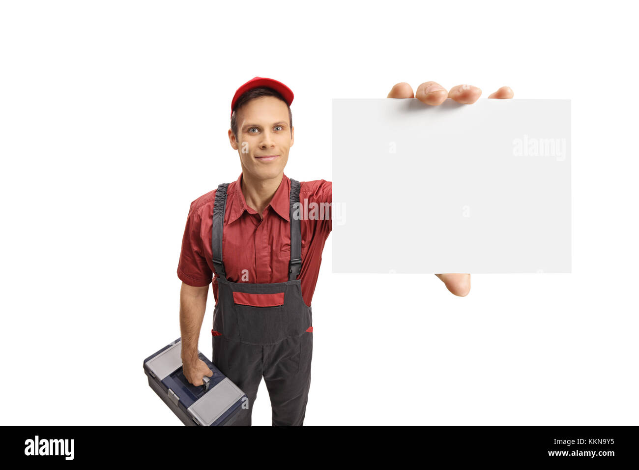 Serviceman with a toolbox showing a blank card isolated on white background - Stock Image