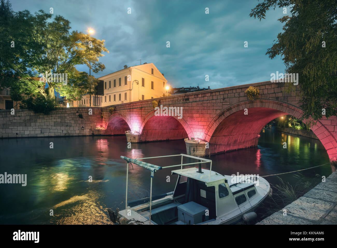 Cityscape with old bridge in city centre at night. Crikvenica, Croatia - Stock Image