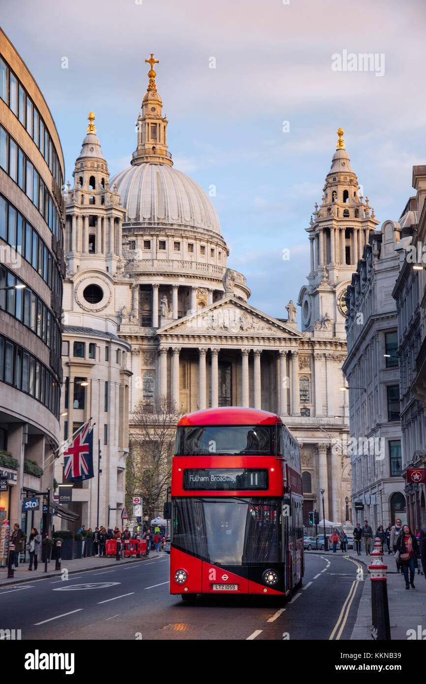 Red London double-decker bus in front of St Paul's Cathedral in the City of London financial district - Stock Image