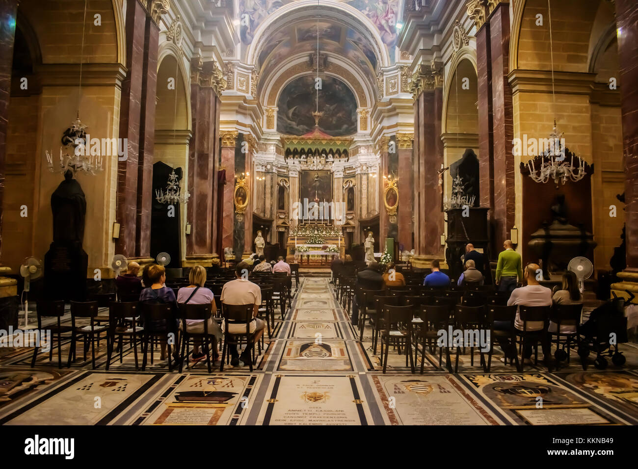 People gathering in St. Paul`s Cathedral in Mdina, Malta. - Stock Image