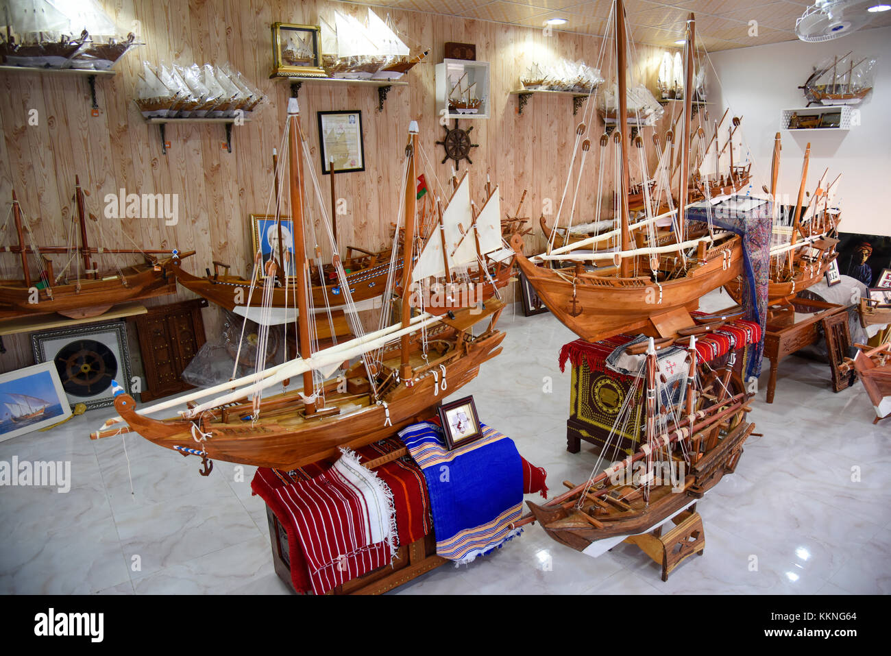 Oman Sur A crafts store with tiny models of dhows or traditional sailing vessels - Stock Image