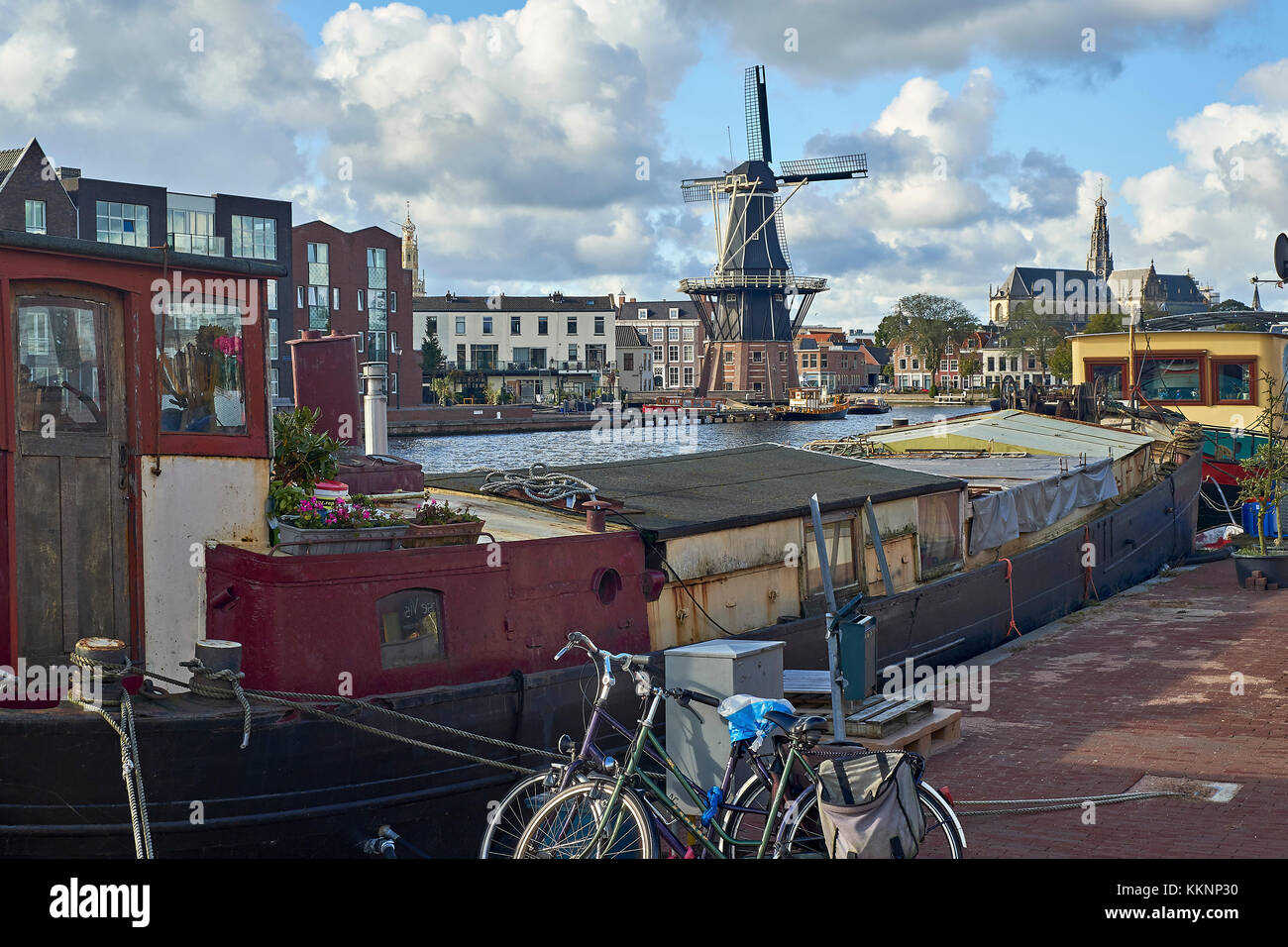 Adriaan windmill with houseboat in Haarlem, North Holland, Netherlands - Stock Image