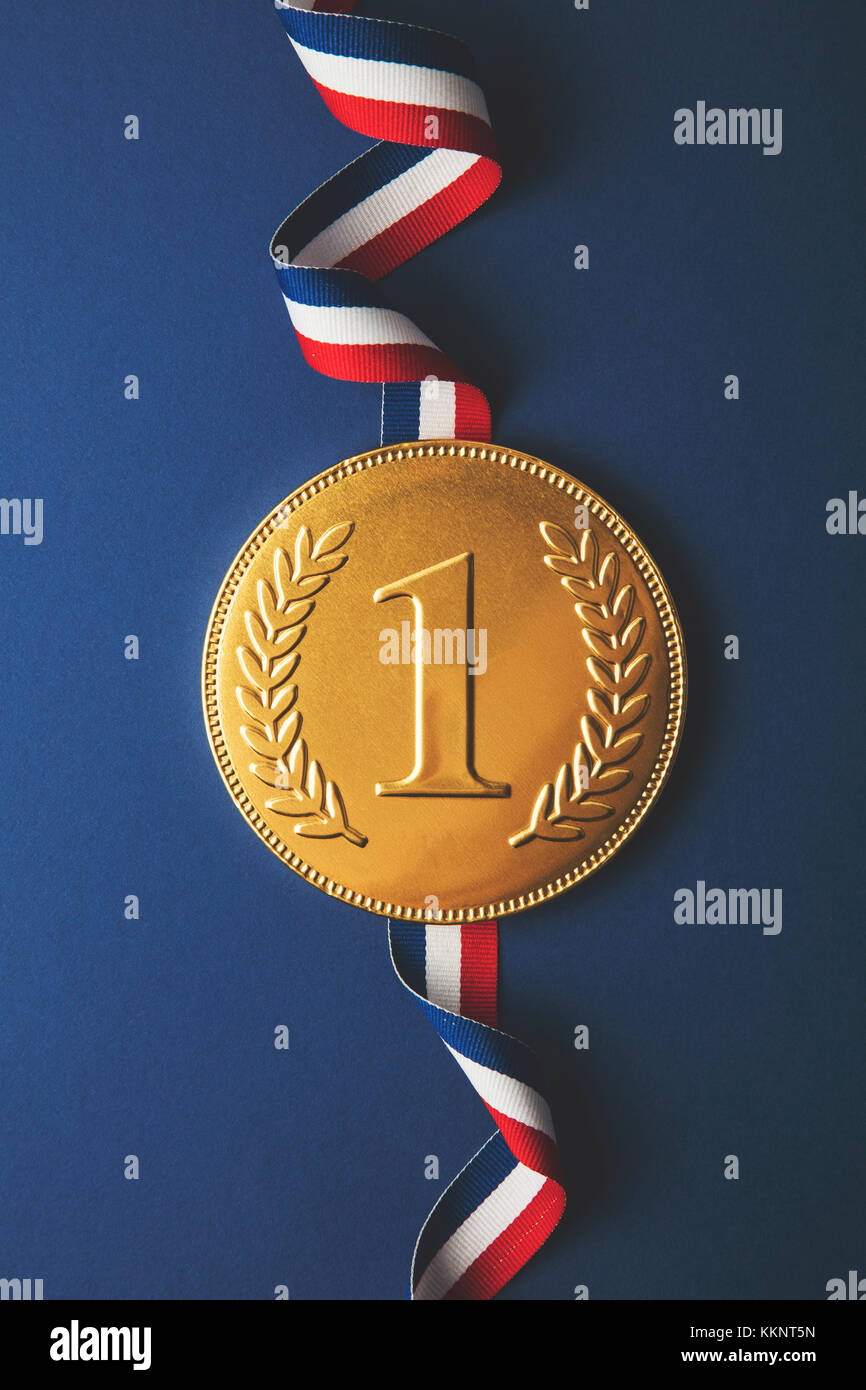 Gold first place winners medal. Success achievement concept - Stock Image