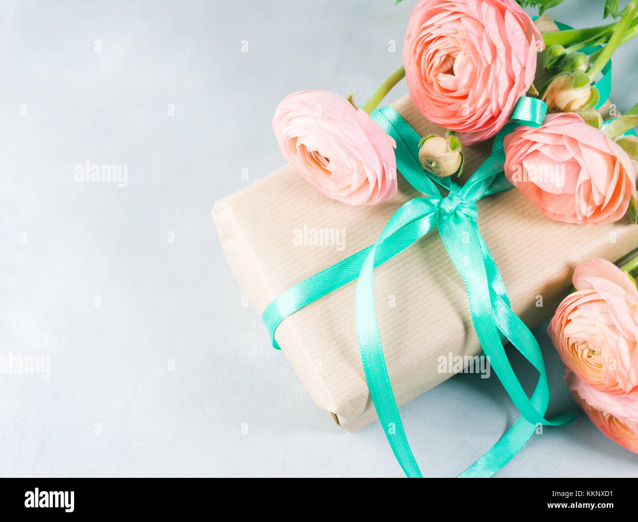 Beautiful Pink ranunculus flowers bouquet and gift box. Valentine ...