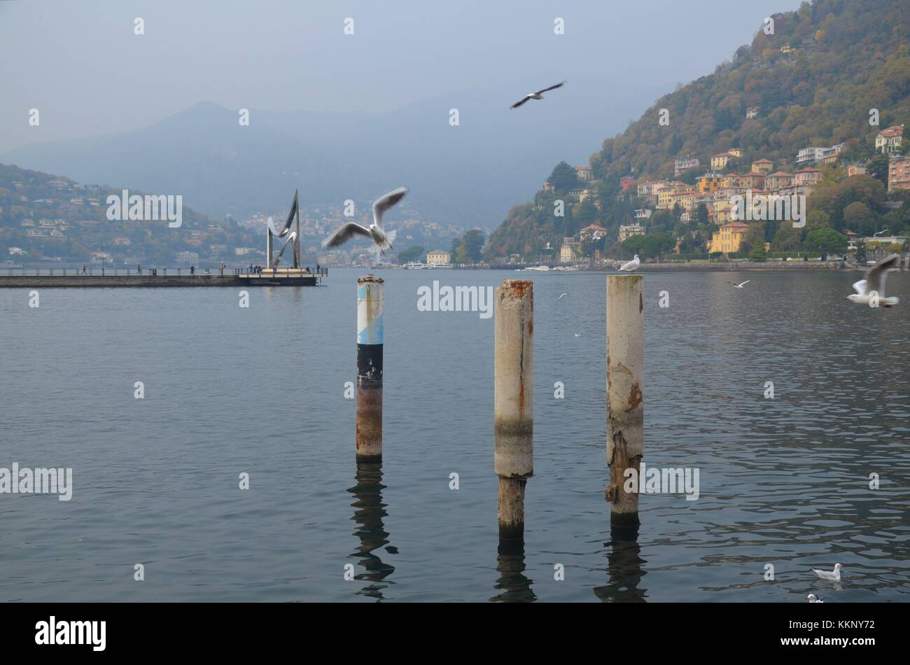 The Italian town of Como at the Swiss border: A view of the lake in autumn - Stock Image